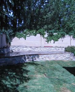 stone enclosure around a backyard